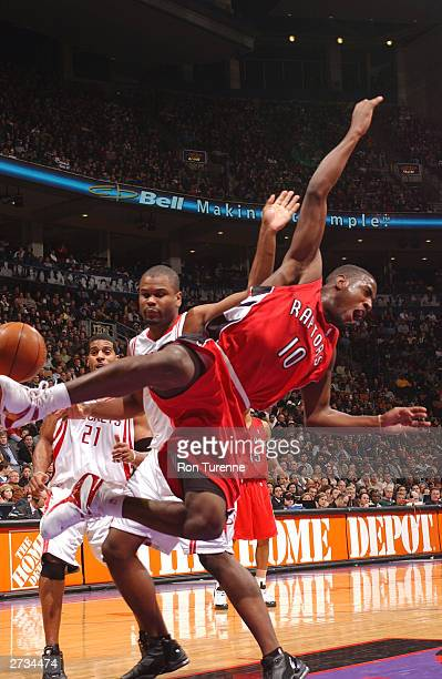 Milt Palacio of the Toronto Raptors draws the foul on Alton Ford of the Houston Rockets on November 16 2003 at the Air Canada Centre in Toronto...