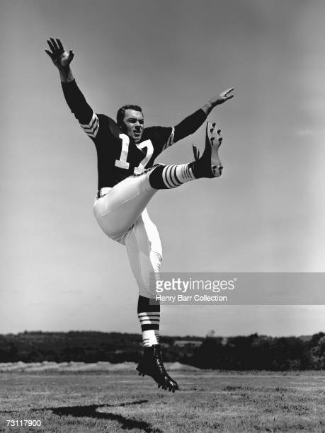 Milt Plum of the Cleveland Browns poses for an action portrait during training camp in July 1957 at Hiram College in Hiram Ohio