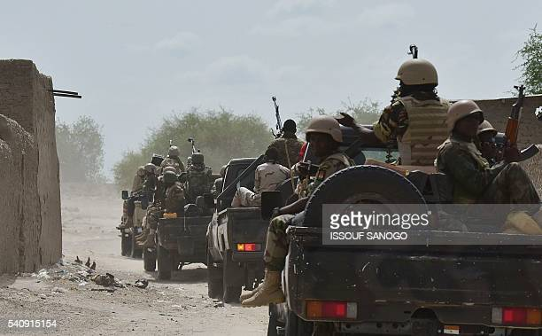 A miltary convoy drives in the city of Bosso on June 17 2016 following attacks by Boko Haram fighters in the region Boko Haram on June 9 attacked a...