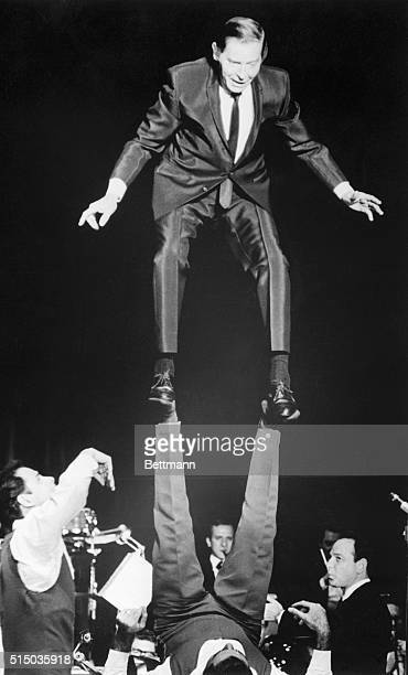 Milton Berle gets into the act with the acrobatic Amin Brothers, performers in his revue at the Circus Maximus room at Caesar's Palace hotel and...