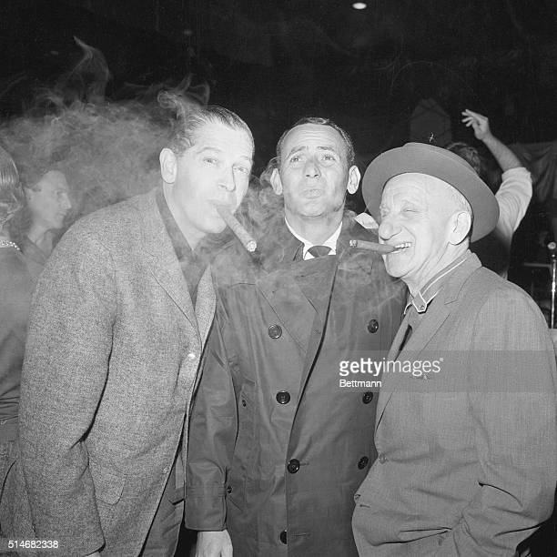 Milton Berle , Joey Bishop , and Jimmy Durante smoke cigars during a reheasal for the gala planned for John Kennedy's inauguration.