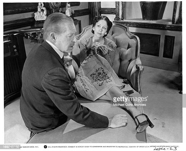 Milton Berle sits with Anjanette Comer in a scene from the film 'Lepke' 1975