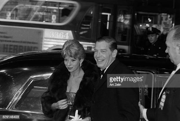 Milton Berle with his wife Ruth Cosgrove Rosenthal getting out of a limousine; circa 1970; New York.