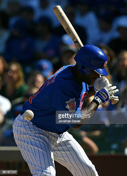 Milton Bradley of the Chicago Cubs is hit by a pitch from Nelson Figueroa of the New York Mets in the 5th inning on August 30 2009 at Wrigley Field...