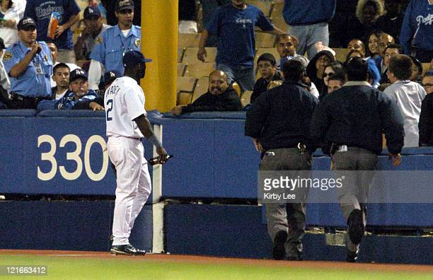Milton Bradley of the Los Angeles Dodgers confronts fans after a beer bottle was thrown at the right fielder after dropping a fly ball in the eighth...