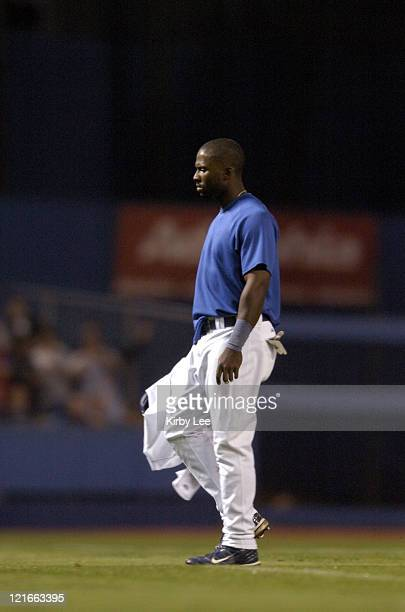 Milton Bradley of the Los Angeles Dodgers walks off field after being ejected after confronting fans when a beer bottle was thrown at the right...