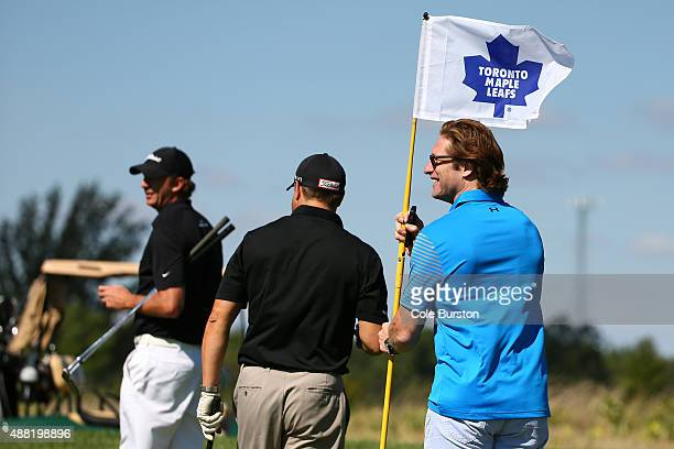 Milton Canada September 14 Former Toronto Maple Leaf Shayne Corson holds the flag for other golfers on the green of the annual Leafs Legends Charity...
