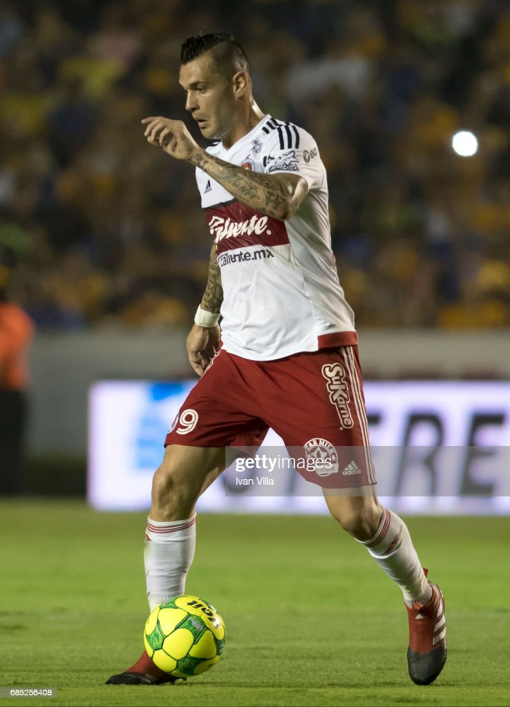 Milton Caraglio drives the ball during the semi finals first leg match between Tigres UANL and Tijuana as part of the Torneo Clausura 2017 Liga MX Universitario Stadium on May 18, 2017 in Monterrey, Mexico.