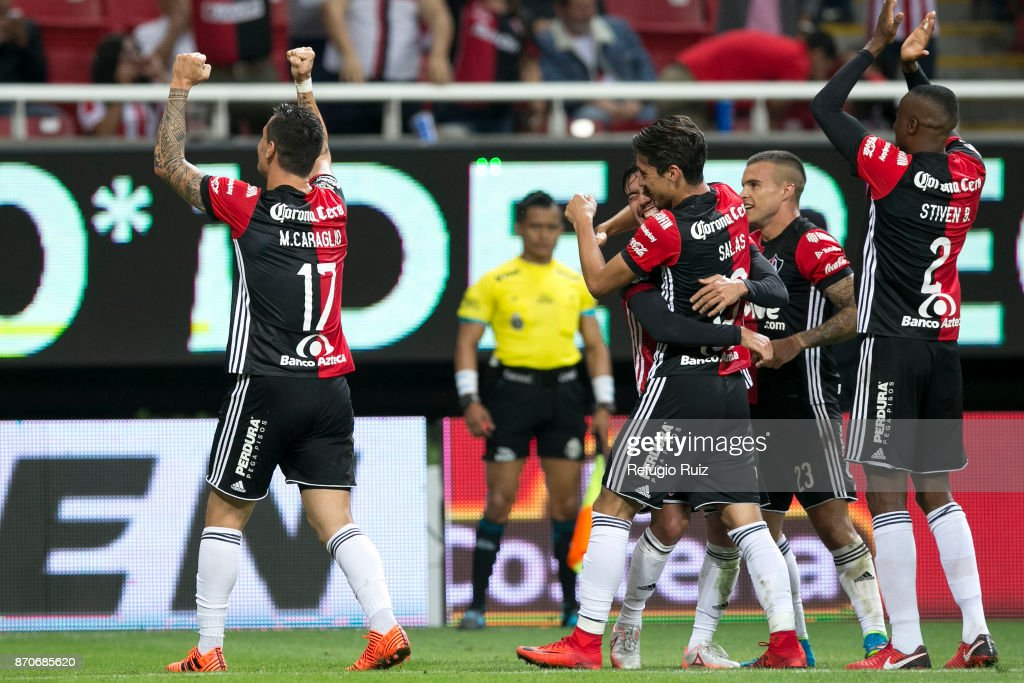 Milton Caraglio of Atlas celebrates with teammates after scoring the second goal of his team during the 16th round match between Chivas and Atlas as part of the Torneo Apertura 2017 Liga MX at Chivas Stadium on November 4, 2017 in Zapopan, Mexico.