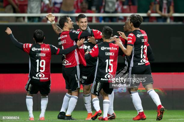 Milton Caraglio of Atlas celebrates with teammates after scoring the second goal of his team during the 16th round match between Chivas and Atlas as...