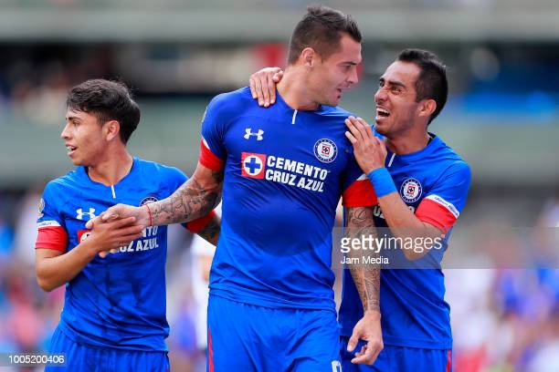 Milton Caraglio of Cruz Azul celebrates after scoring the second goal of his team with teammates Josue Dominguez and Rafael Baca during the 1st round...