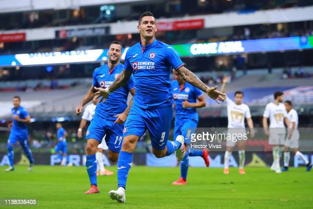 Milton Caraglio of Cruz Azul celebrates after scoring the second goal of his team during the 15th round match between Cruz Azul and Pumas UNAM as...