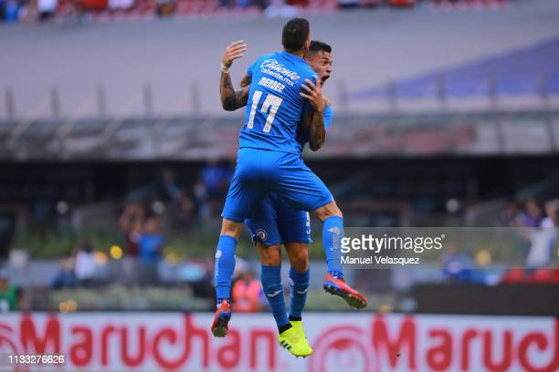 Milton Caraglio of Cruz Azul celebrates with teammate Edgar Mendez after scoring the equalizer during the 9th round match between Cruz Azul and...