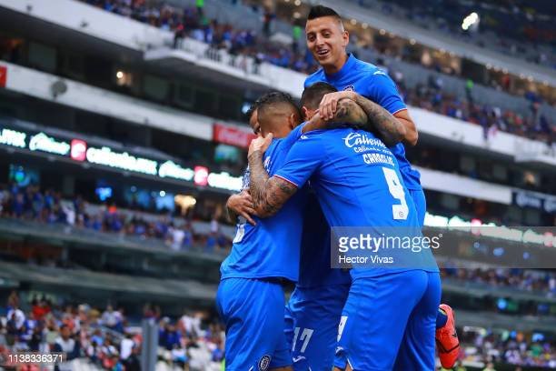 Milton Caraglio of Cruz Azul celebrates with teammates after scoring the second goal of his team during the 15th round match between Cruz Azul and...