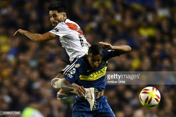 Milton Casco of River Plate and Agustin Almendra compete for the ball during a match between Boca Juniors and River Plate as part of Superliga...