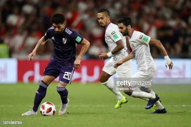 Milton Casco of River Plate breaks away from Hussein El Shahat and Caio of Al Ain during the FIFA Club World Cup UAE 2018 Semi Final Match between...