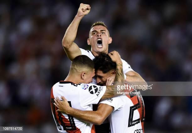 Milton Casco of River Plate celebrates with teammates Rafael Santos Borre and Juan Fernando Quintero after Alejandro Donatti of Racing scores an own...