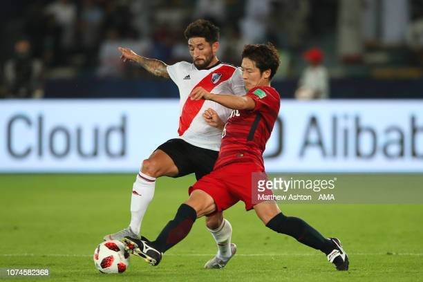 Milton Casco of River Plate competes with Ryota Nagaki of Kashima Antlers during the FIFA Club World Cup UAE third place match between Kashima...
