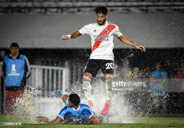 Milton Casco of River Plate fights for the ball with John Fajardo of Binacional during a Group D match between River Plate and Deportivo Binacional...