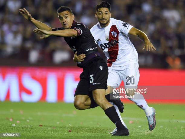 Milton Casco of River Plate fights for the ball with Maximiliano Velazquez of Lanus during a second leg match between Lanus and River Plate as part...