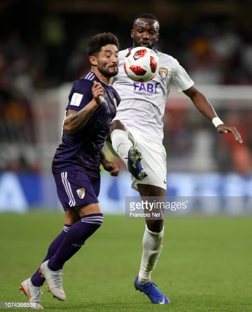 Milton Casco of River Plate is challenged by Tongo Doumbia of Al Ain during the FIFA Club World Cup UAE 2018 Semi Final Match between River Plate and...