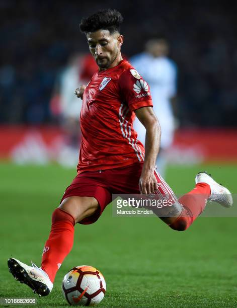 Milton Casco of River Plate kicks the ball during a round of sixteen first leg match between River Plate and Racing Club as part of Copa CONMEBOL...