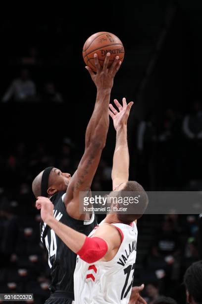 Milton Doyle of the Brooklyn Nets and Jonas Valanciunas of the Toronto Raptors tipoff on March 13 2018 at Barclays Center in Brooklyn New York NOTE...