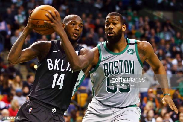 Milton Doyle of the Brooklyn Nets drives to the basket past Greg Monroe of the Boston Celtics during a game at TD Garden on April 11 2018 in Boston...