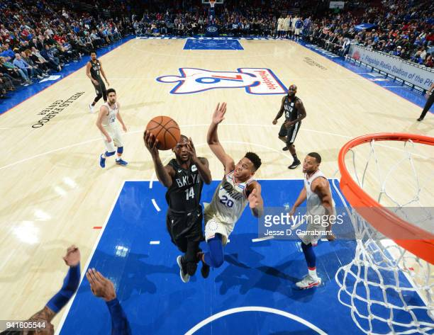 Milton Doyle of the Brooklyn Nets goes up for the layup against the Philadelphia 76ers at Wells Fargo Center on April 3 2018 in Philadelphia...