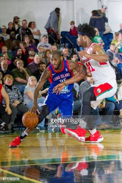 Milton Doyle of the Long Island Nets drives against Devin Williams of the Maine Red Claws on Sunday January 28 2018 at the Portland Expo in Portland...