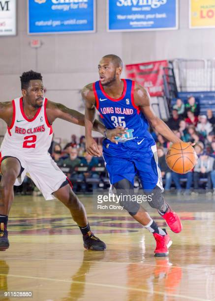Milton Doyle of the Long Island Nets drives around LJ Peak of the Maine Red Claws on January 28 2018 at the Portland Expo in Portland Maine NOTE TO...