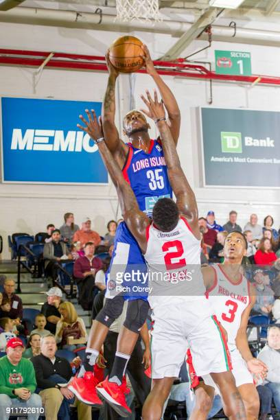 Milton Doyle of the Long Island Nets shoots over LJ Peak of the Maine Red Claws on Sunday January 28 2018 at the Portland Expo in Portland Maine NOTE...