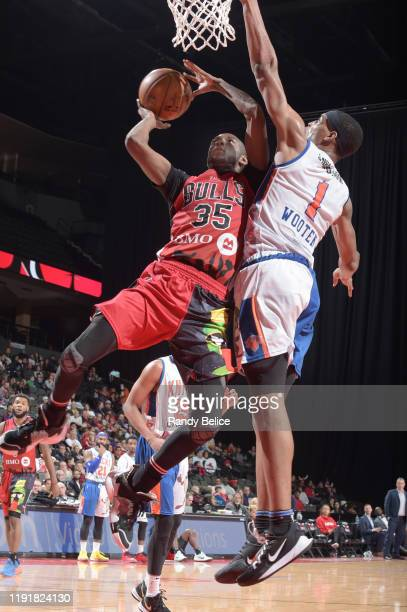 Milton Doyle of the Windy City Bulls shoots over Kenny Wooten of the Westchester Knicks at the Sears Centre on January 4 2020 in Hoffman Estates...