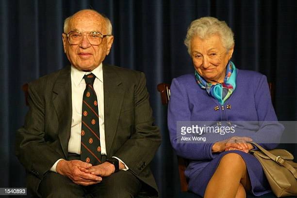 Milton Friedman , recipient of the 1976 Nobel Prize for economic science, sits with his wife Rose May 9, 2002 during a White House event in...