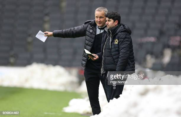 Milton Keynes Dons assistant manager Keith Millen makes a point to manager Dan Micciche during the Sky Bet League One match between Milton Keynes...