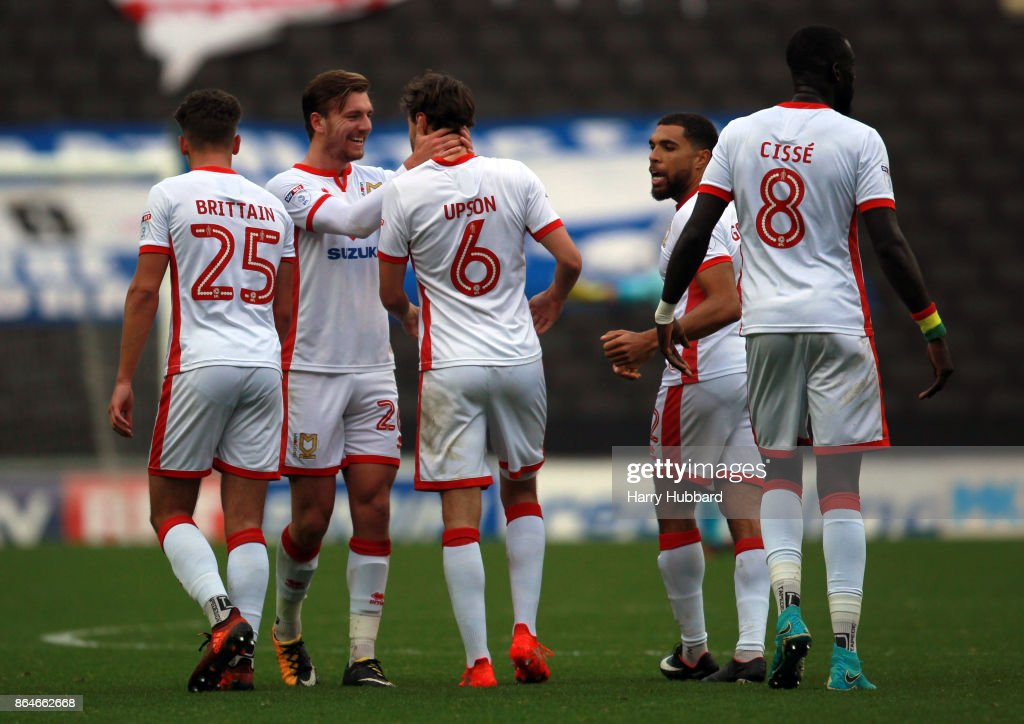 Milton Keynes Dons celebrate Ed Upson's first goal during the Sky Bet League One match between Milton Keynes Dons and Oldham Athletic at StadiumMK on October 21, 2017 in Milton Keynes, England.