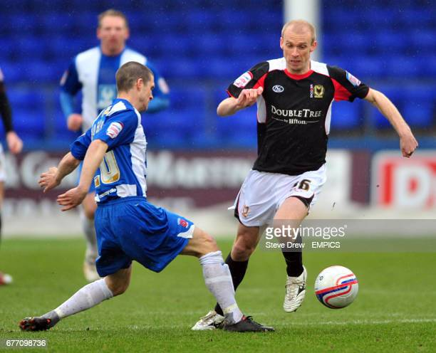 MIlton Keynes Dons' Luke Chadwick is challenged by Hartlepool United's Paul Murray
