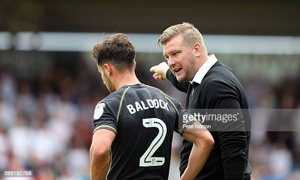 Milton Keynes Dons manager Karl Robinson make a point to George Baldock during the Sky Bet League One match between Northampton Town and Milton...