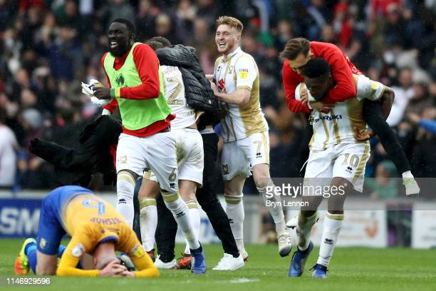 Milton Keynes Dons players celebrate as their team are promoted after the Sky Bet League Two match between Milton Keynes Dons and Mansfield Town at...