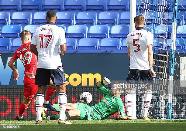 Milton Keynes Dons Ryan Colclough scores his sides first goal beating Bolton Wanderers Mark Howard during the Sky Bet League One match between Bolton...