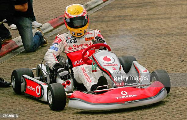 British F1 racing driver Lewis Hamilton prepares to race in a gokart at the Daytona International karting track in Milton Keynes in southern England...