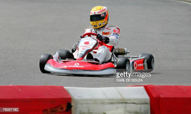 British F1 racing driver Lewis Hamilton races in a gokart at the Daytona International karting track in Milton Keynes in southern England 05 July...