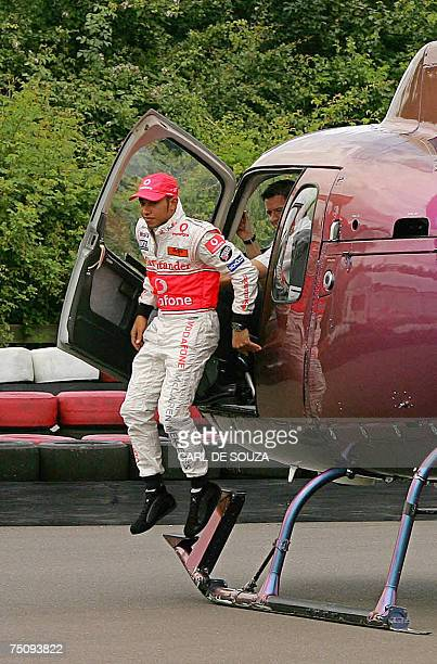 British F1 racing driver Lewis Hamilton jumps from his helicopter as he prepares to race in a gokart at the Daytona International karting track in...