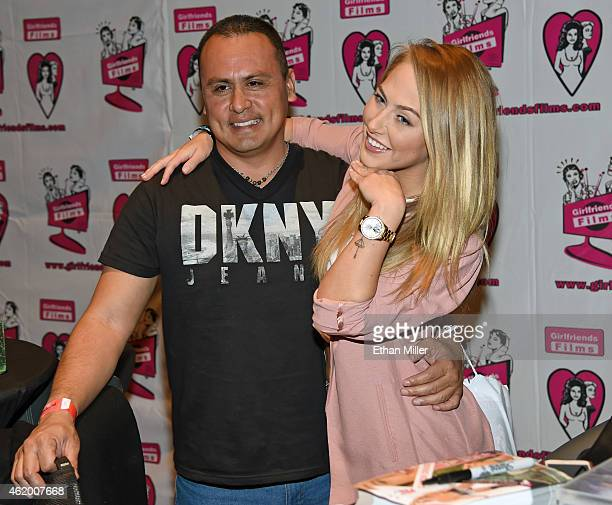 Milton Ortiz poses with adult film actress Carter Cruise at the Girlfriends Films booth at the 2015 AVN Adult Entertainment Expo at The Joint inside...