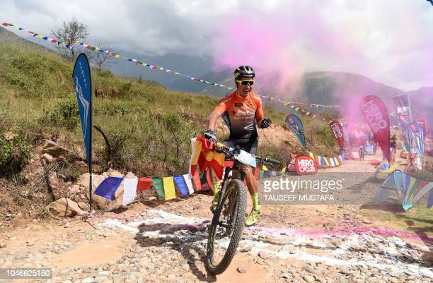 Milton Ramos of Spain celebrates as he wins the Hero MTB Himalaya mountain bike race at the finishing point in Dharamshala northern Indian state of...