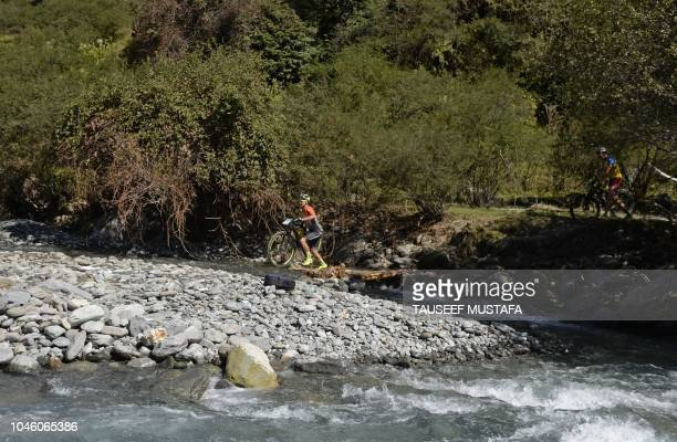 Milton Ramos of Spain competes in the 14th edition of the Hero MTB Himalaya mountain bike race in the northern Indian state of Himachal Pradesh on...