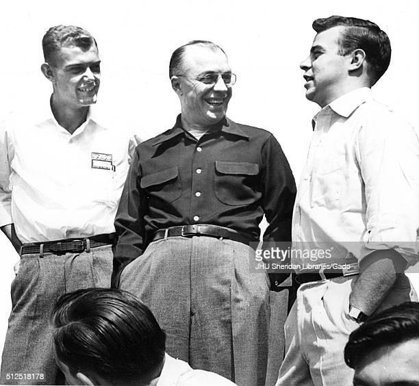 Milton Stover Eisenhower president of Johns Hopkins University chatting with student leaders at Mont Alto Encampment 1965