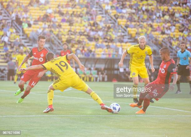 Milton Valenzuela of Columbus Crew SC and Auro of Toronto FC battle fo the ball during the game between the Columbus Crew SC and the Toronto FC at...
