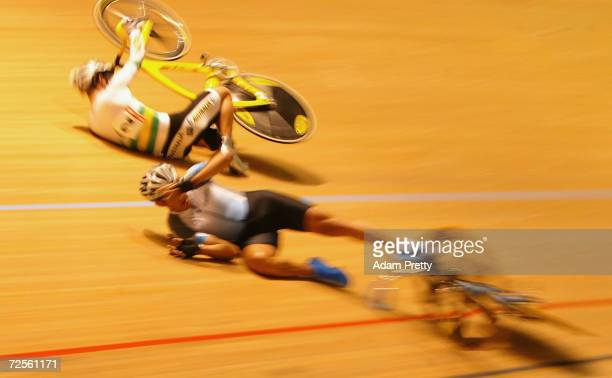 Milton Wynants of Uruguay and Mark Renshaw of Australia crash during the mens points race during day one the UCI Track Cycling World Championships at...