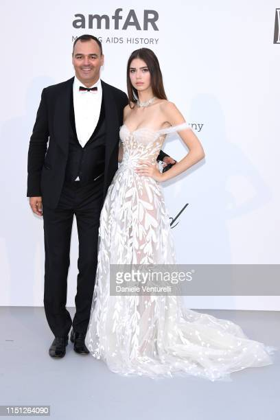 Milutin Gatsby and Helena Gatsby attend the amfAR Cannes Gala 2019 at Hotel du CapEdenRoc on May 23 2019 in Cap d'Antibes France